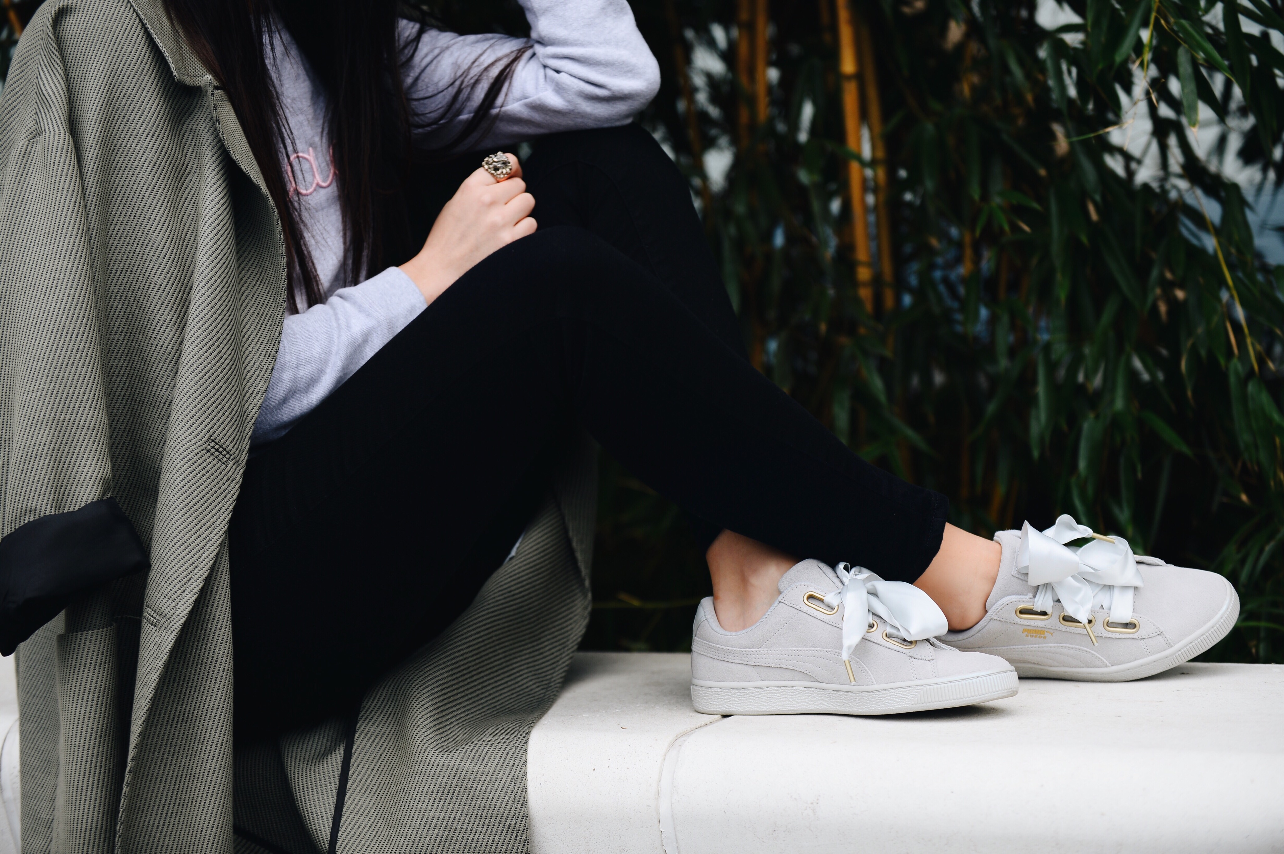 Levi's jeans and Puma sneakers